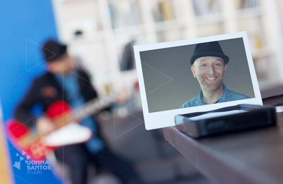 Concept Portrait of musician in foreground with out of focus image of him in the background